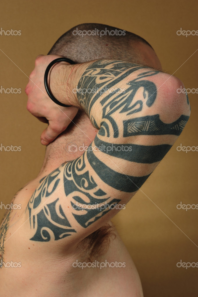 Tribal tattoo on the right arm — Stock Photo #9354587