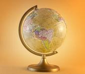 Globe on yellow — Stock Photo