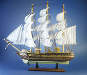 Sailing ship on blue — Stock Photo
