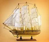 Sailing ship on yellow — Stock Photo