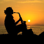 Woman Playing the Saxophone at Sunset — Stock Photo