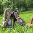 Two girls on the meadow — Stock Photo
