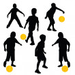 Stock Photo: Silhouettes of children playing football