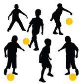 Silhouettes of children playing football — Stock Photo