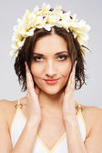 Young beautiful woman in flower crown — Stock Photo