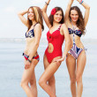 Lovely women having fun on the beach — Stock Photo