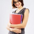 Young confident businesswoman with folders — Stock Photo