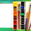 Stock Photo: Watercolor paints with brushes