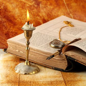 Candle with book — Stock Photo
