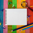 Stock Photo: Notebook on colored background
