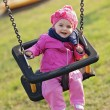 Happy baby playing with the swing — Stock Photo #9135112