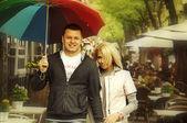 Man and woman walking near caffe — Stock Photo