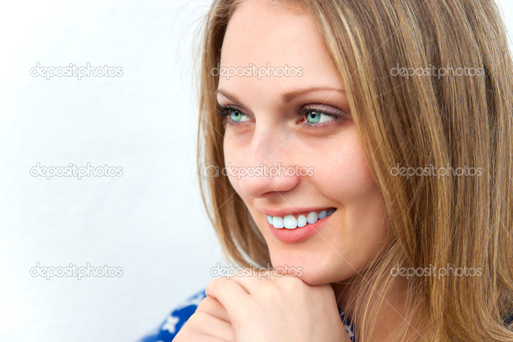 Portrait of beautiful smiling girl with blond hair. — Stock Photo #10649139