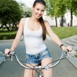 Girl and bicycle — Stock Photo #10615230