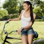 Girl and bicycle — Stock Photo