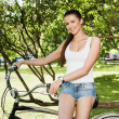 Girl and bicycle — Stock Photo #10721343