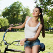 Girl and bicycle — Stock Photo