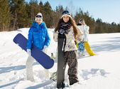 Three young snowboarders — Stockfoto