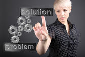 Problem solving concept - business woman touching screen — Stock Photo