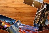 Photos on the wood desk — Stock Photo