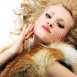 Sensuality young attractive girl with fur coat — Foto Stock
