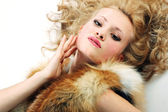 Sensuality young attractive girl with fur coat — Stock Photo