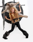 Vogue style photo of young girl in a fur coat — Stock Photo