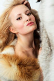 Sensuality young attractive girl with foxy fur jacket — Stock Photo