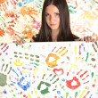 Girl with hand painted in colorful paints ready for hand prints - Stock Photo