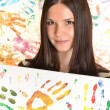 Girl with hand painted in colorful paints ready for hand prints - Photo