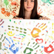 Girl with hand painted in colorful paints ready for hand prints — Stock Photo #10042007