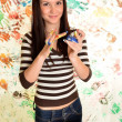 Girl with hand painted in colorful paints ready for hand prints — Foto Stock