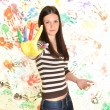 Girl with hand painted in colorful paints ready for hand prints — Stock Photo #10042042