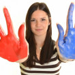 Girl with hand painted in colorful paints ready for hand prints — Stock Photo #10042074