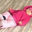 Portrait of adorable baby in pink dress - Foto de Stock