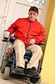 Man with Down syndrome on a wheelchair — Stock Photo