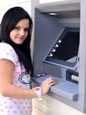 Woman withdrawing money from credit card at ATM. — Foto de Stock