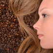 Woman with coffee beans — Stock Photo