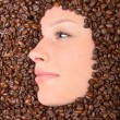 Woman and coffee beans — Stock Photo