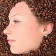 Woman in coffee beans - Stock Photo