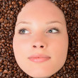 Woman in coffee beans — ストック写真