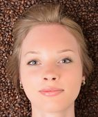 Woman in coffee beans — Stock Photo