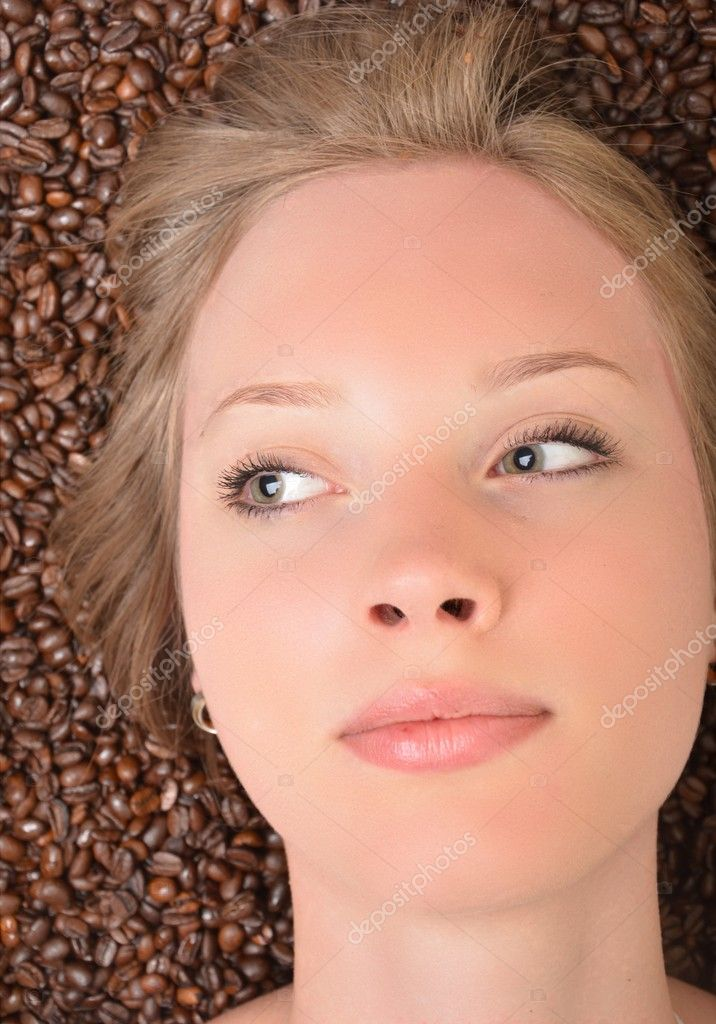 Woman in coffee beans — Stock Photo #10491555