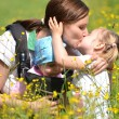 Mother with her two daughters on meadow — Stock Photo #10586911
