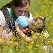 Mother with her two daughters on meadow — Stock Photo #10586920