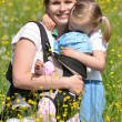 Mother with her two daughters on meadow — Stock Photo #10586922