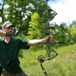 Portrait of a professional archer - Stock Photo