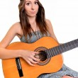 Sexy young woman with guitar — Stock Photo