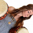 Pretty girl playing the drums or tom toms with her hands - Foto Stock