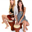 Two girls with bongo - Stock Photo
